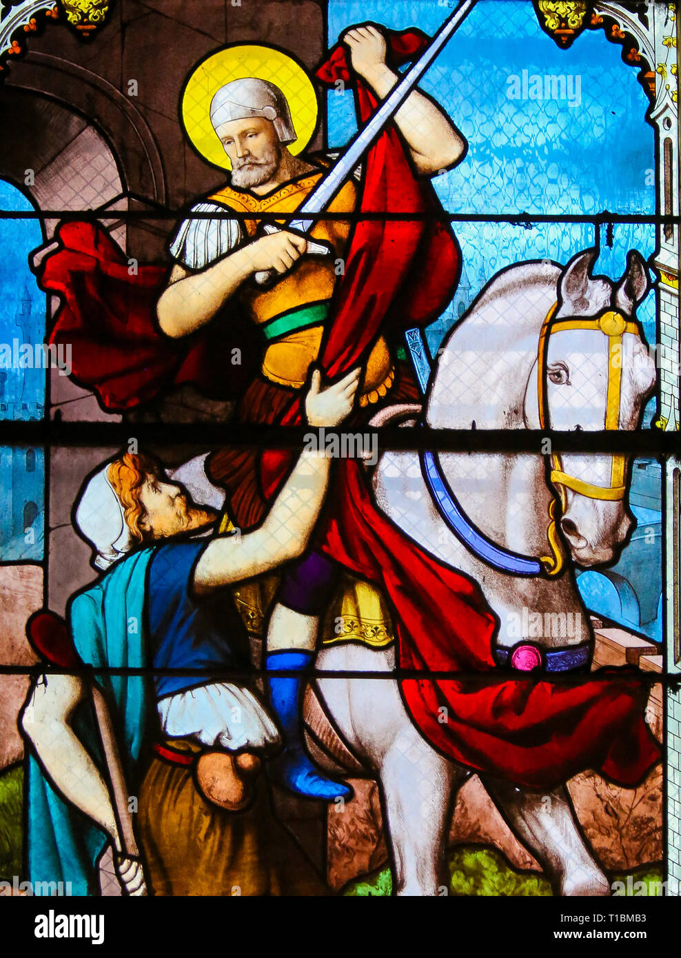 Stained Glass in the Church of Saint Severin, Latin Quarter, Paris, France, depicting St Martin of Tours handing out a piece of cloak to a beggar - Stock Image