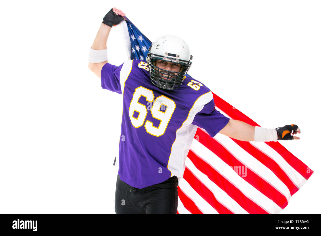 026d9639bac American flag on the shoulders of a male football player Stock Photo ...
