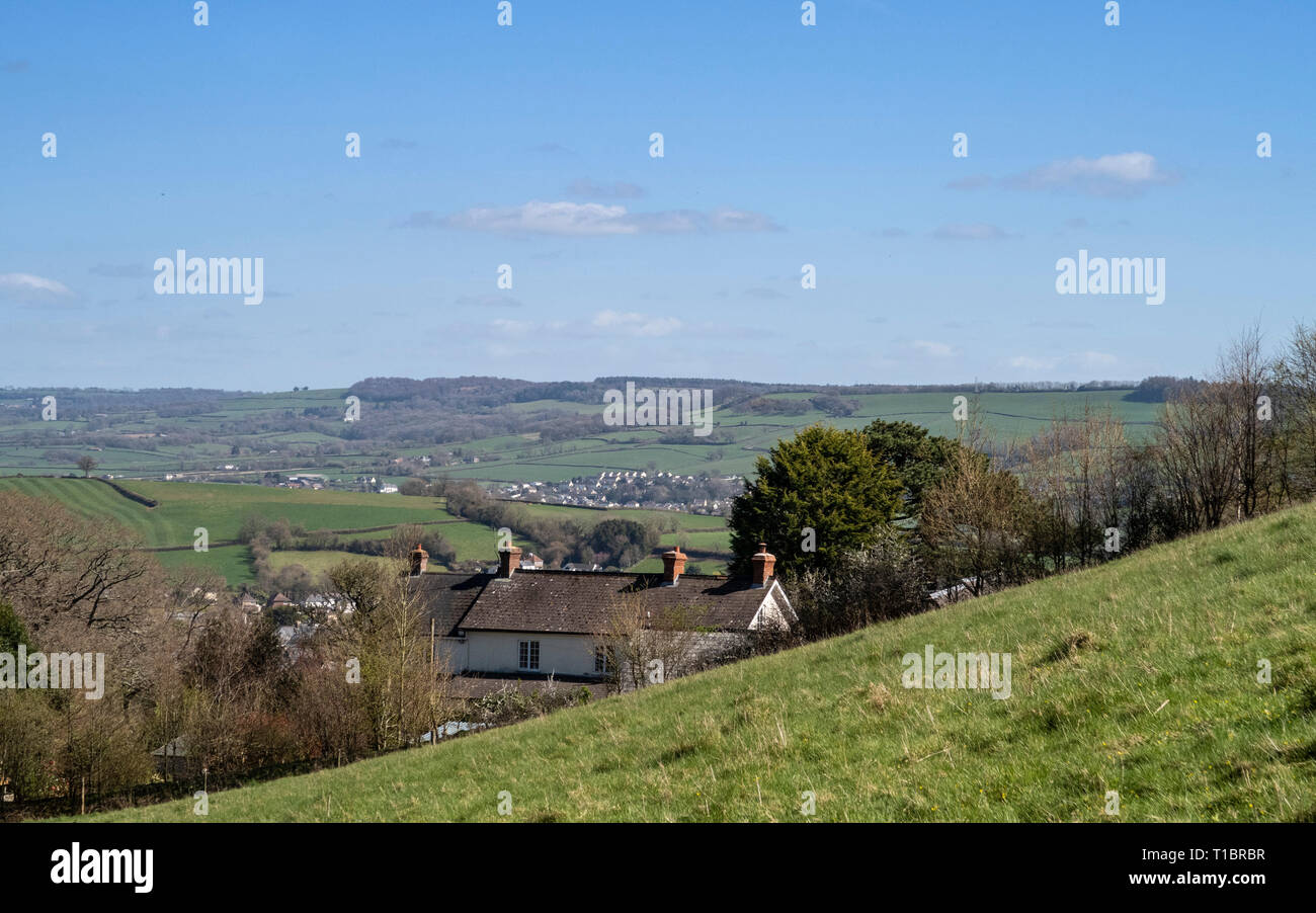 House built into hillside near Colyton, Devon, with fields and open countryside, beautiful views. Stock Photo