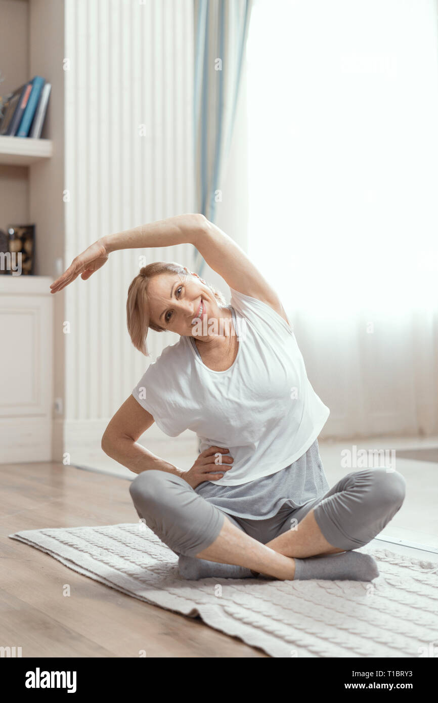 Yoga Classes At Home Beautiful Women Over 50 Years Stock Photo Alamy