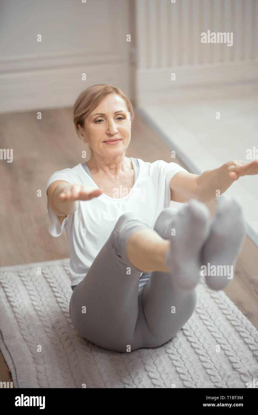 European Looking Woman Over 50 Years Old Doing Yoga At Home In The Living Room Stock Photo Alamy