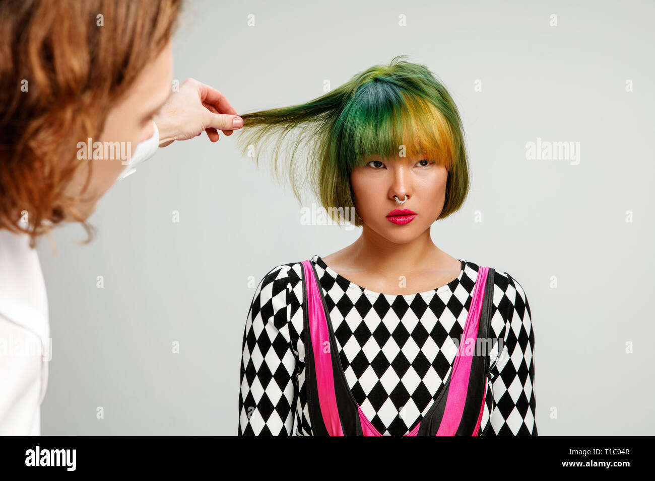 Picture showing adult woman at the hair salon. Studio shot of