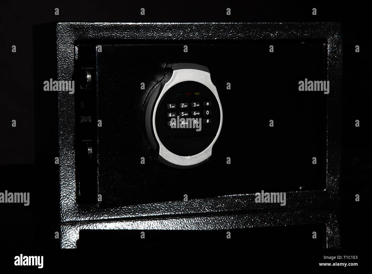 Close Money Safe on black background - Stock Image