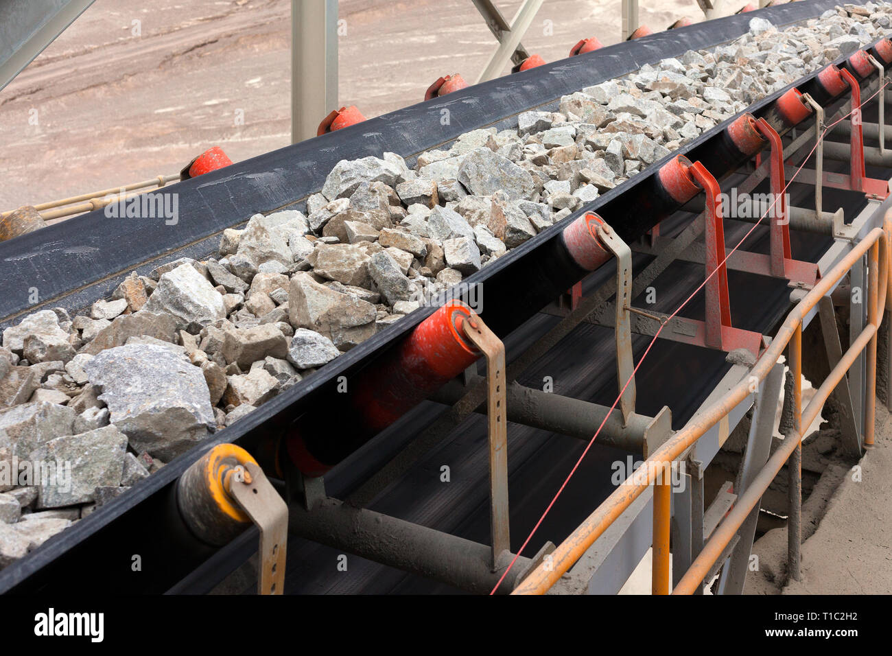 Raw Material on Conveyor Belt before being Crushed at Copper Mine in Northern Chile - Stock Image