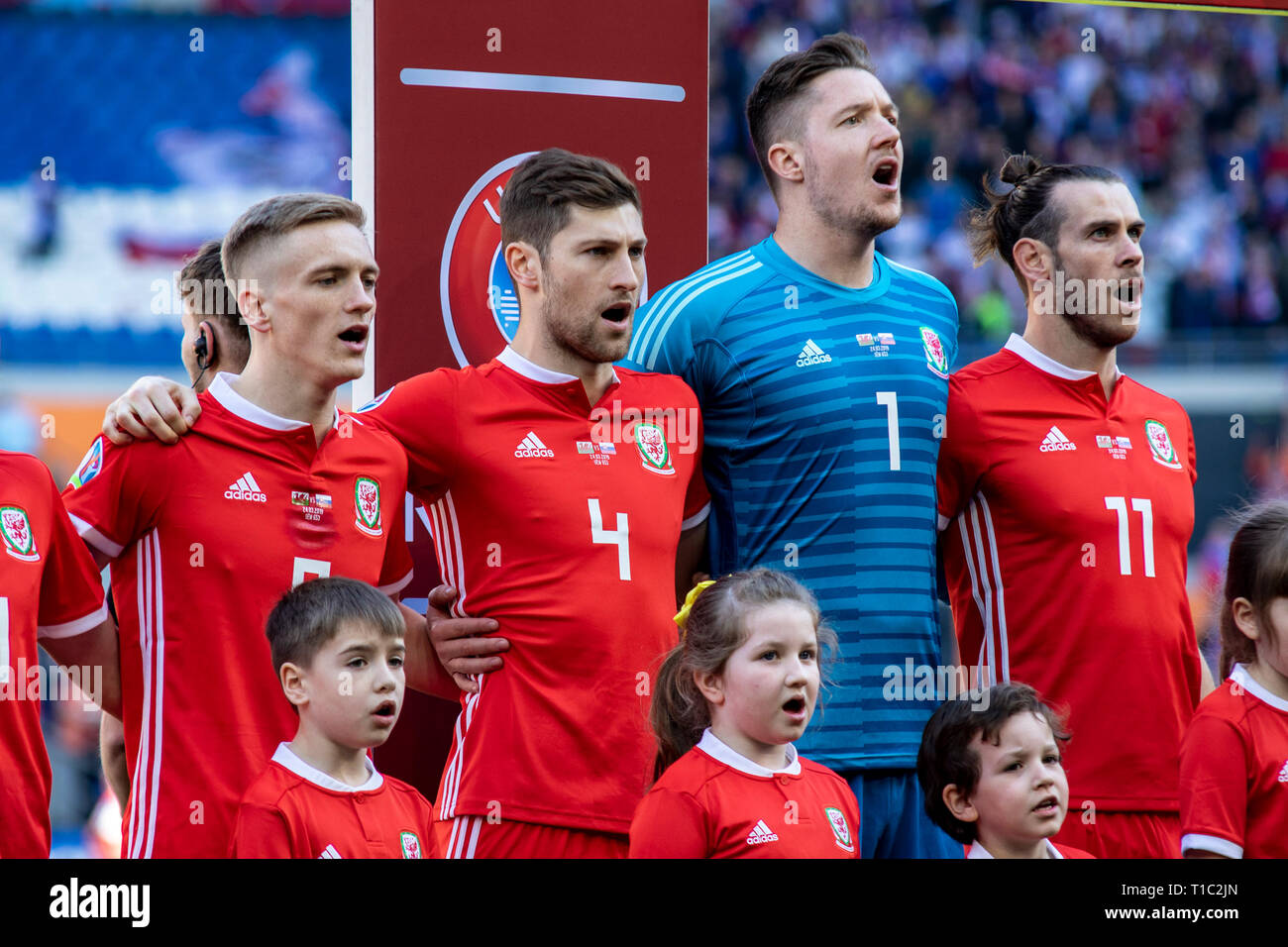 Matt Smith, Ben Davies, Wayne Hennessey & Gareth Bale of Wales  lineup for the national anthem. Wales v Slovakia UEFA Euro 2020 Qualifier in Cardiff. - Stock Image