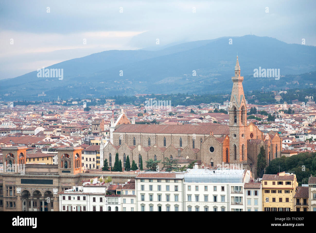 Elevated view over Florence towards the Basilica of Santa Croce at dusk. - Stock Image
