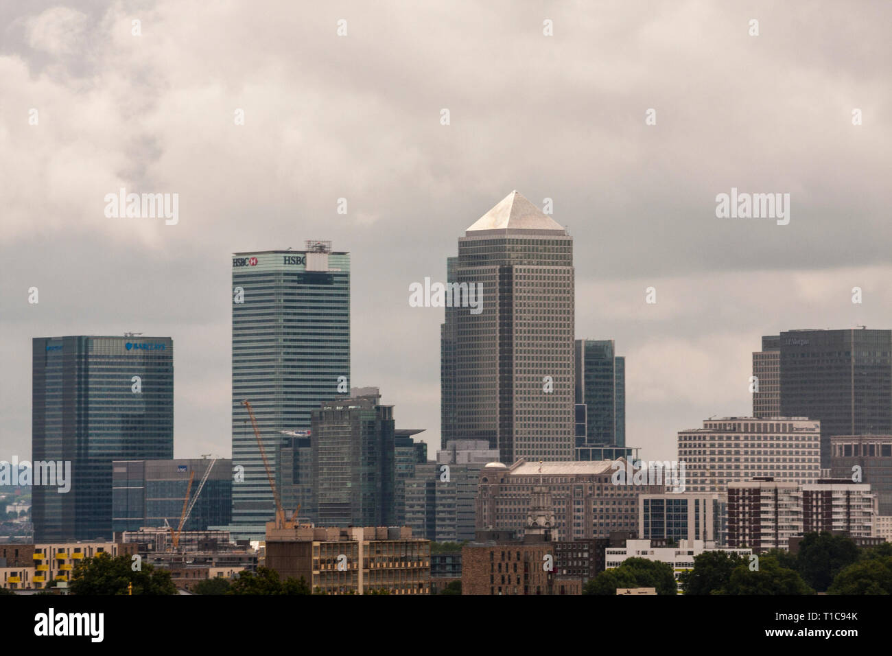 A view of the London skyline over Canary Wharf - Stock Image