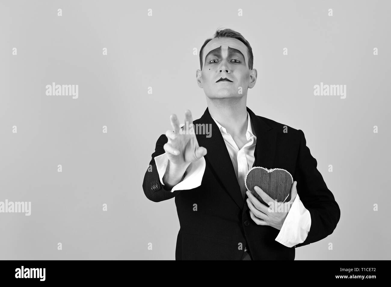 Passionate and poetic. Mime man hold red heart for valentines day. Mime actor with love symbol. Love confession on valentines day. Theatre actor - Stock Image
