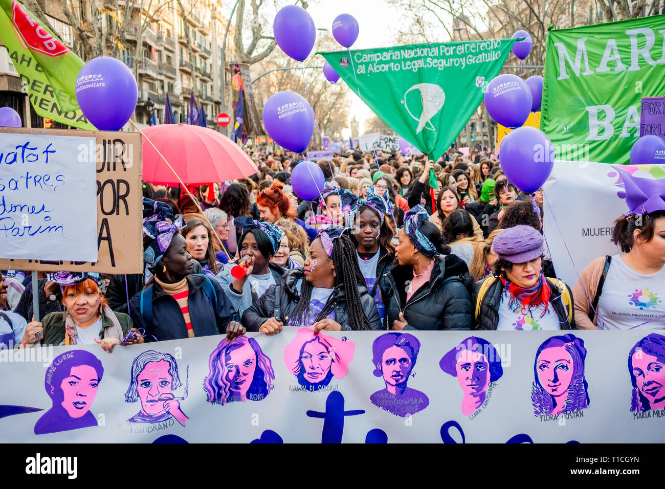 Barcelona, Spain - 8 march 2019:  crows of women rally in the city center during woman's day for better human rights for women and feminism - Stock Image