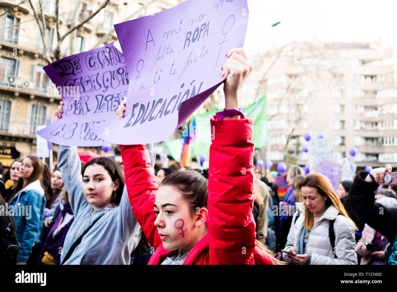 Barcelona, Spain - 8 march 2019:  young girls rally in the city center during woman's day for better human rights for women and feminism - Stock Image