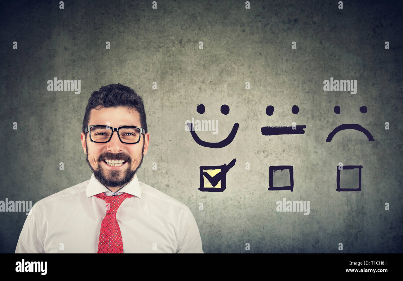 Customer experience concept. Confident happy business man received excellent rating for a satisfaction survey - Stock Image