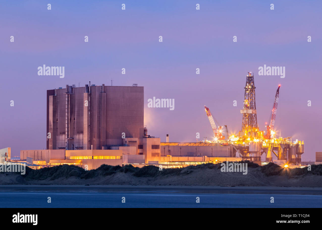 View over North Gare beach and dunes towards Hartlepool nuclear power station. UK. Stock Photo