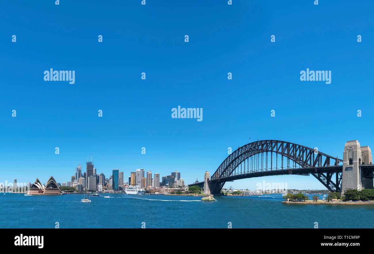 Sydney Harbour Bridge, Sydney Opera House and the Central Business District skyline from Kirribilli, Sydney, Australia - Stock Image