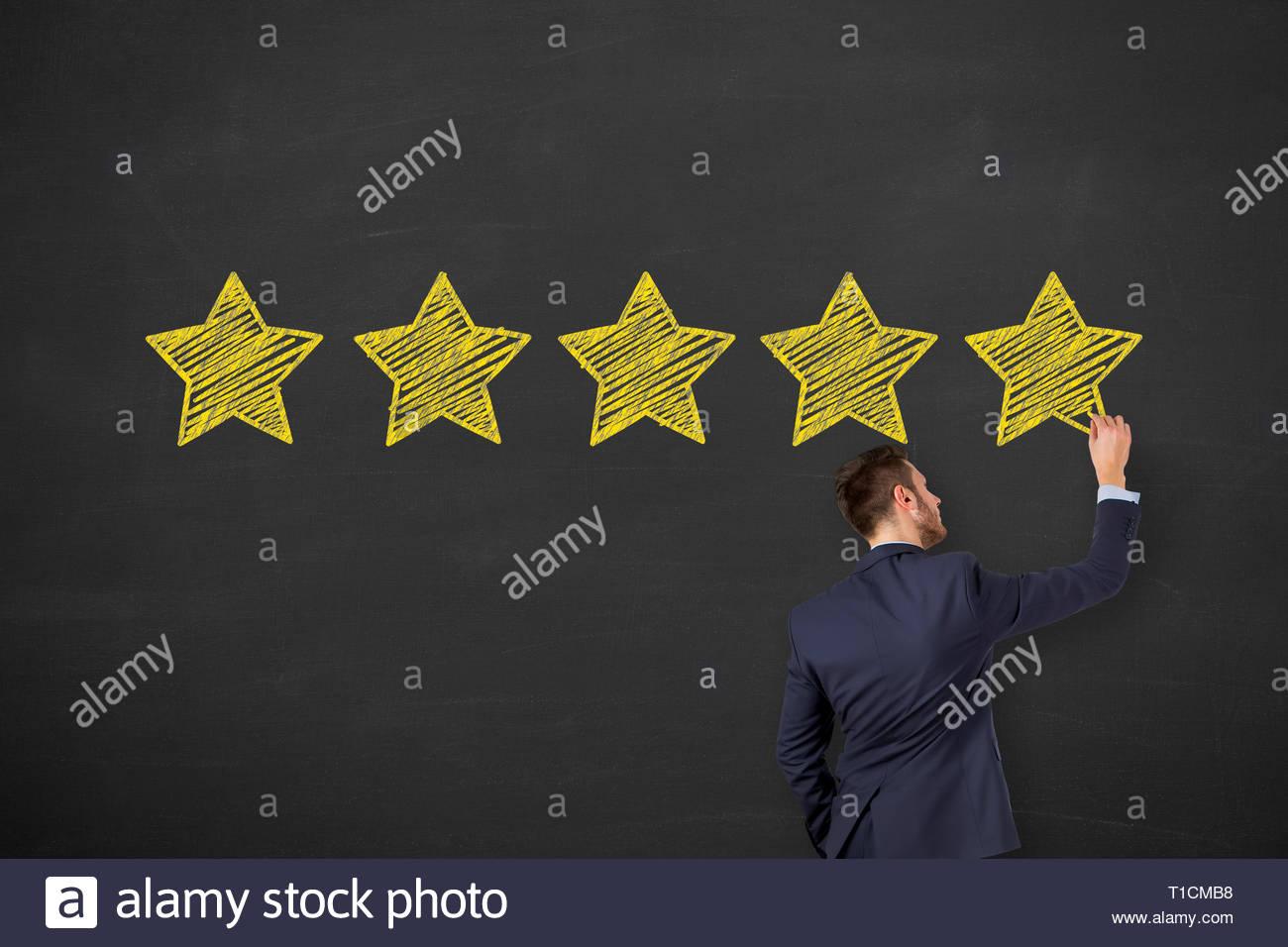 Customer Satisfaction Concepts on Chalkboard Background - Stock Image