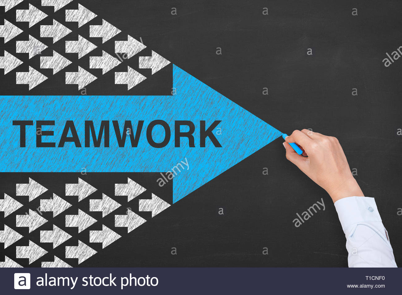 Teamwork Solutions Concepts on Blackboard Background - Stock Image