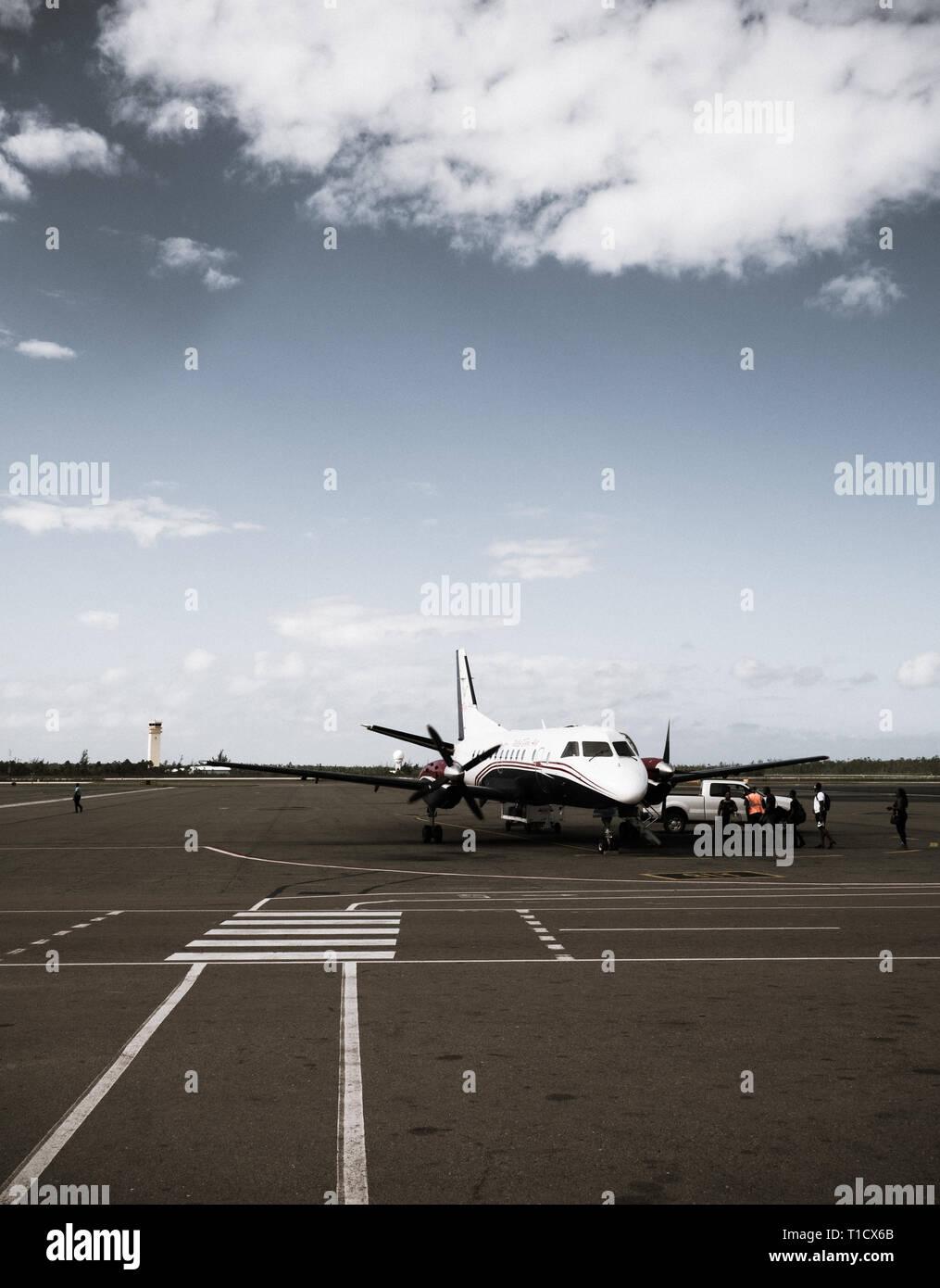 passengers boarding airplane, lynden pindling international