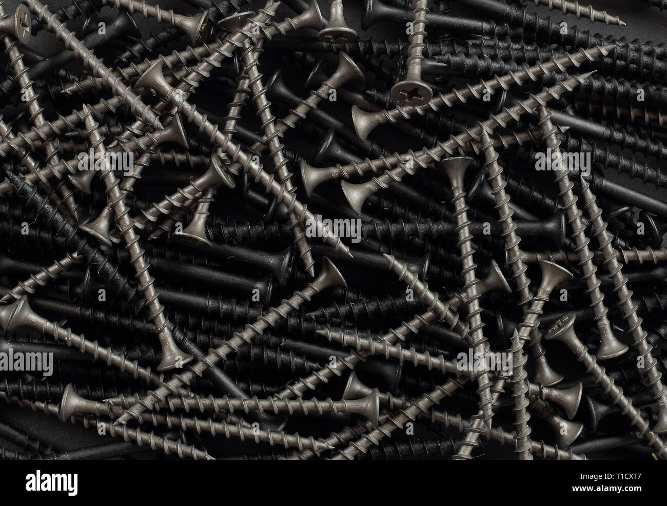 Construction, repair, tools - Abstract Self-tapping screw background Stock Photo