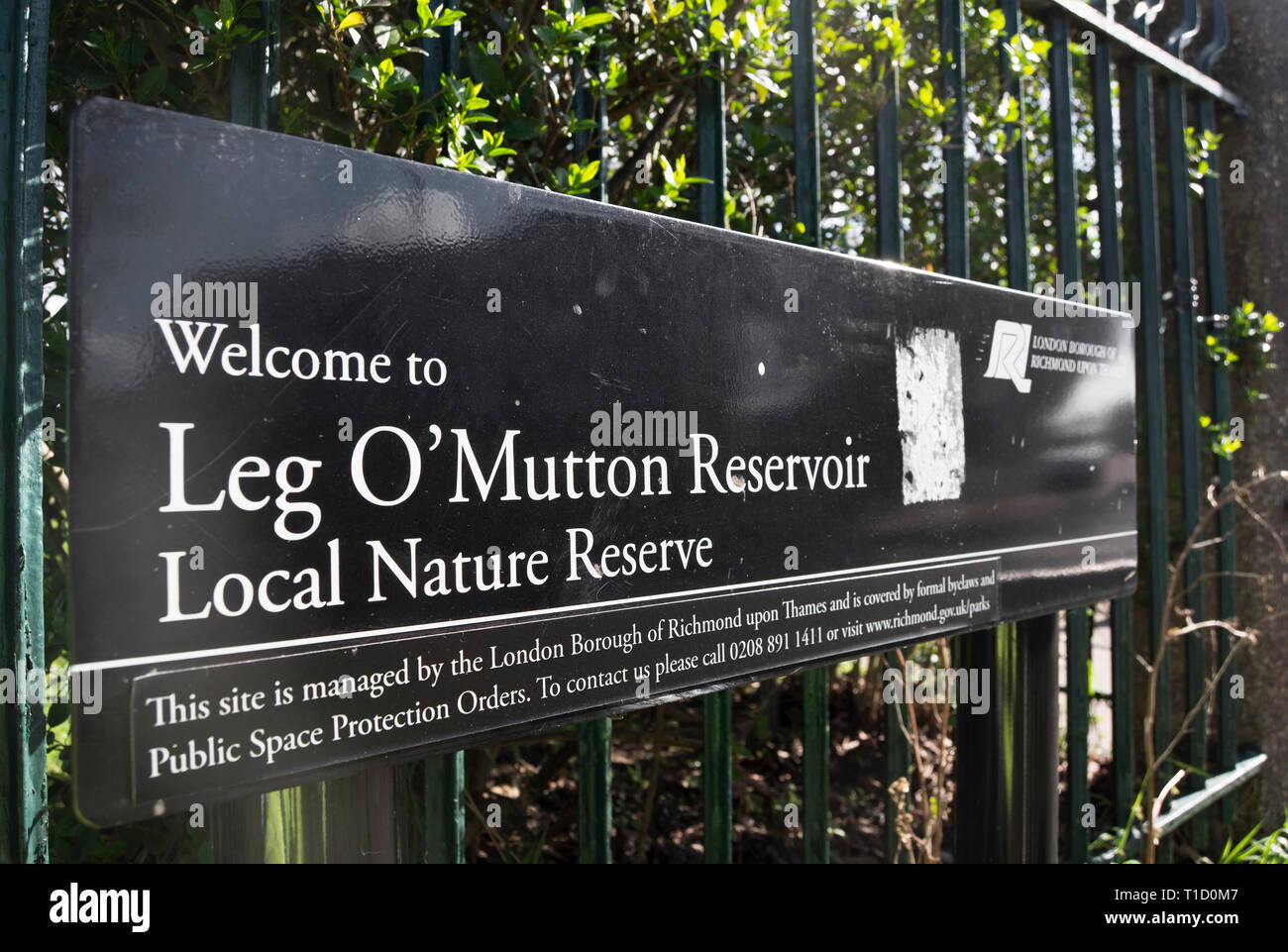 welcome sign at leg o'mutton reservoir, a local nature reserve around a disused reservoir in barnes, london, england - Stock Image