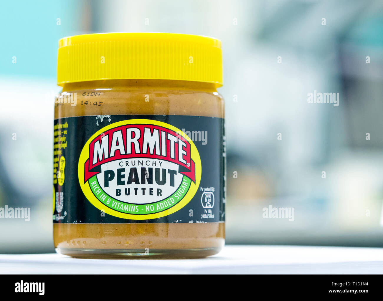 Jar of Marmite Crunchy Peanut Butter, The original Marmite is made by Unilever and first launched in 1902. - Stock Image