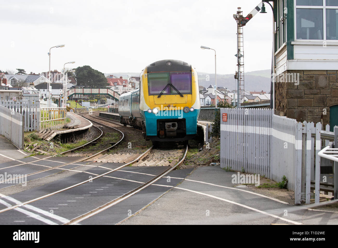 Diesel Multiple Unit Class 175 Coradia departing from Deganwy station, North Wales en route to Llandudno terminus - Stock Image