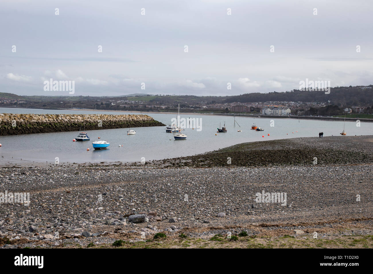 Boats and yachts at anchor in the small harbour inlet at Rhos on Sea, North Wales Stock Photo