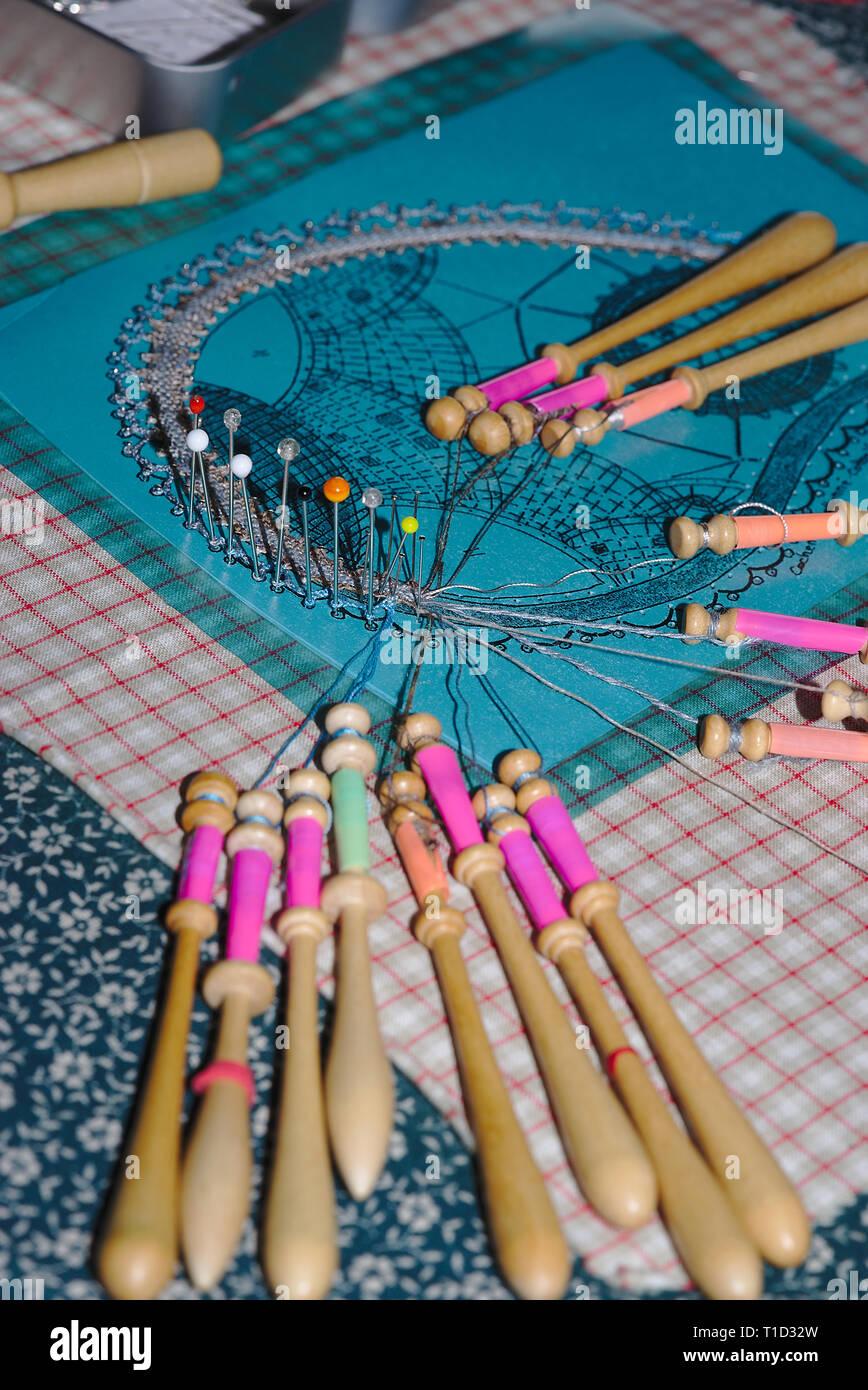 bobbins of lacemaker, realization of work in progress - Stock Image