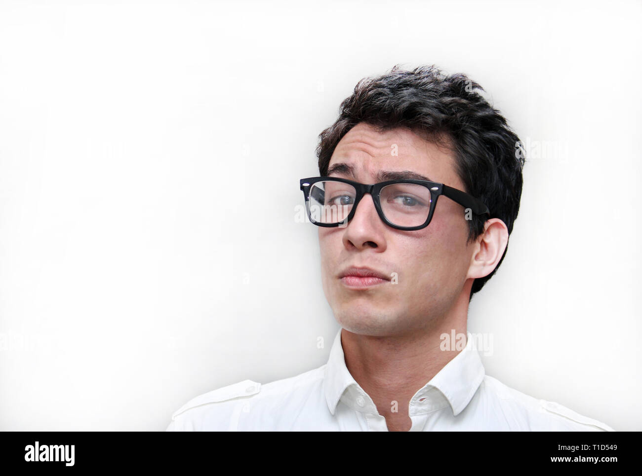Guy with nerd glasses in front of a white background - Stock Image