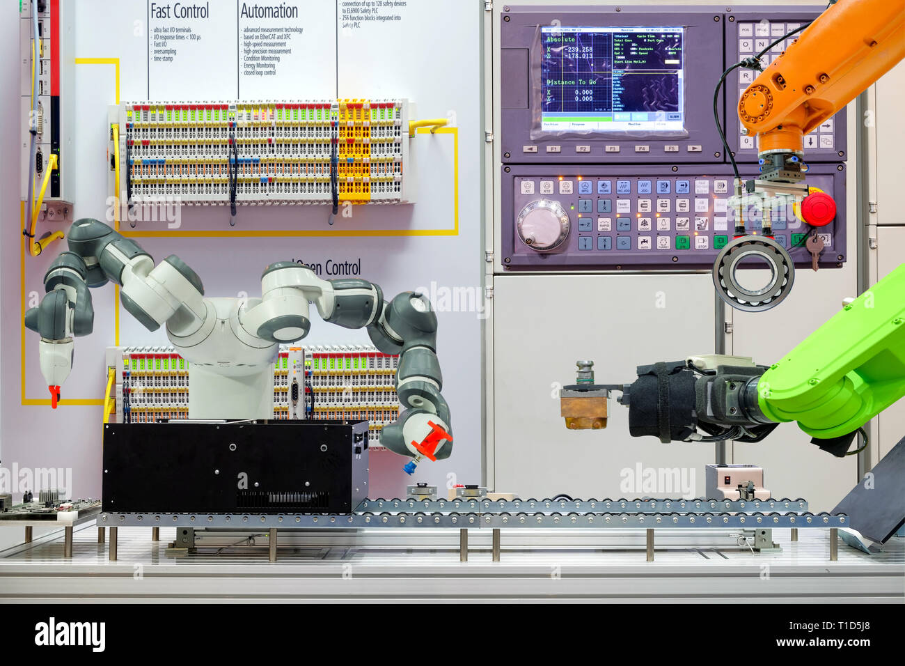 Concept image of industrial robotics  working via conveyor belt on smart factory, terminal and control panel background, industry 4.0 Stock Photo