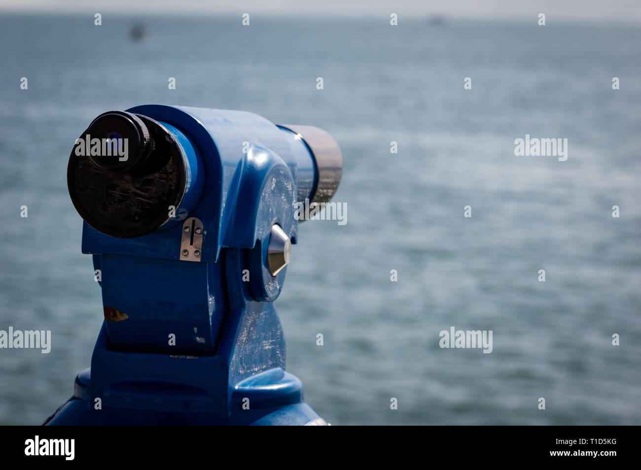 Background of a blue panoramic touristic telescope overlooking the Mediterranean sea - Stock Image