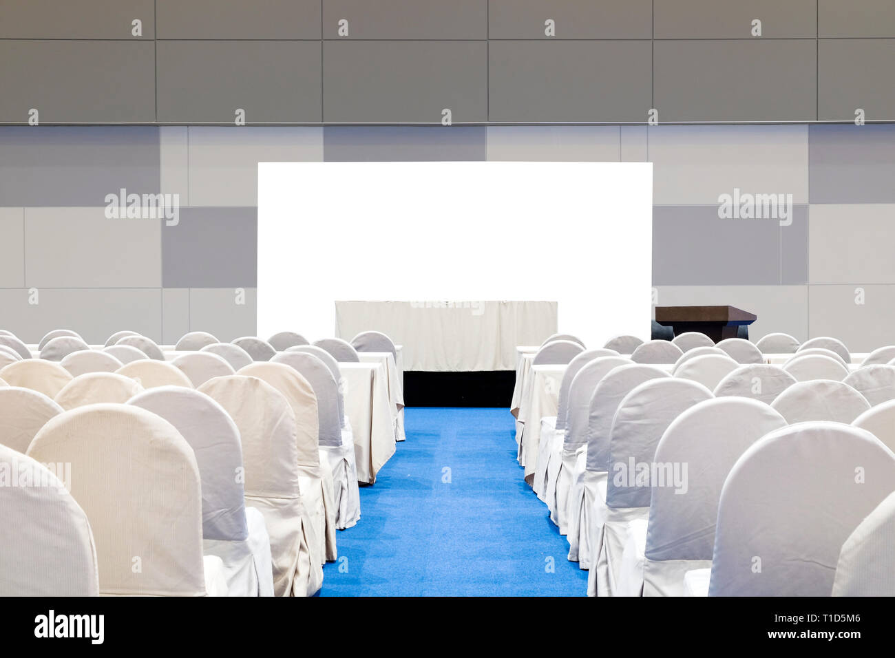 Empty meeting room with stage, table, isolated on white background, podium and chairs for business conference seminar. - Stock Image