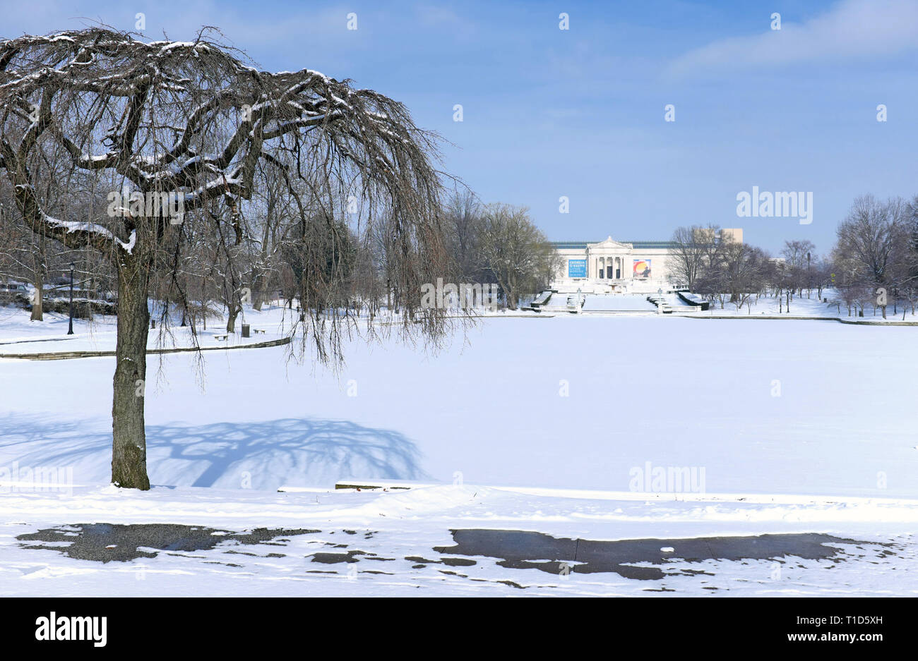 Wade Park and Pond in the University Circle neighborhood of Cleveland, Ohio, USA are covered in January snow in front of the Cleveland Museum of Art. Stock Photo