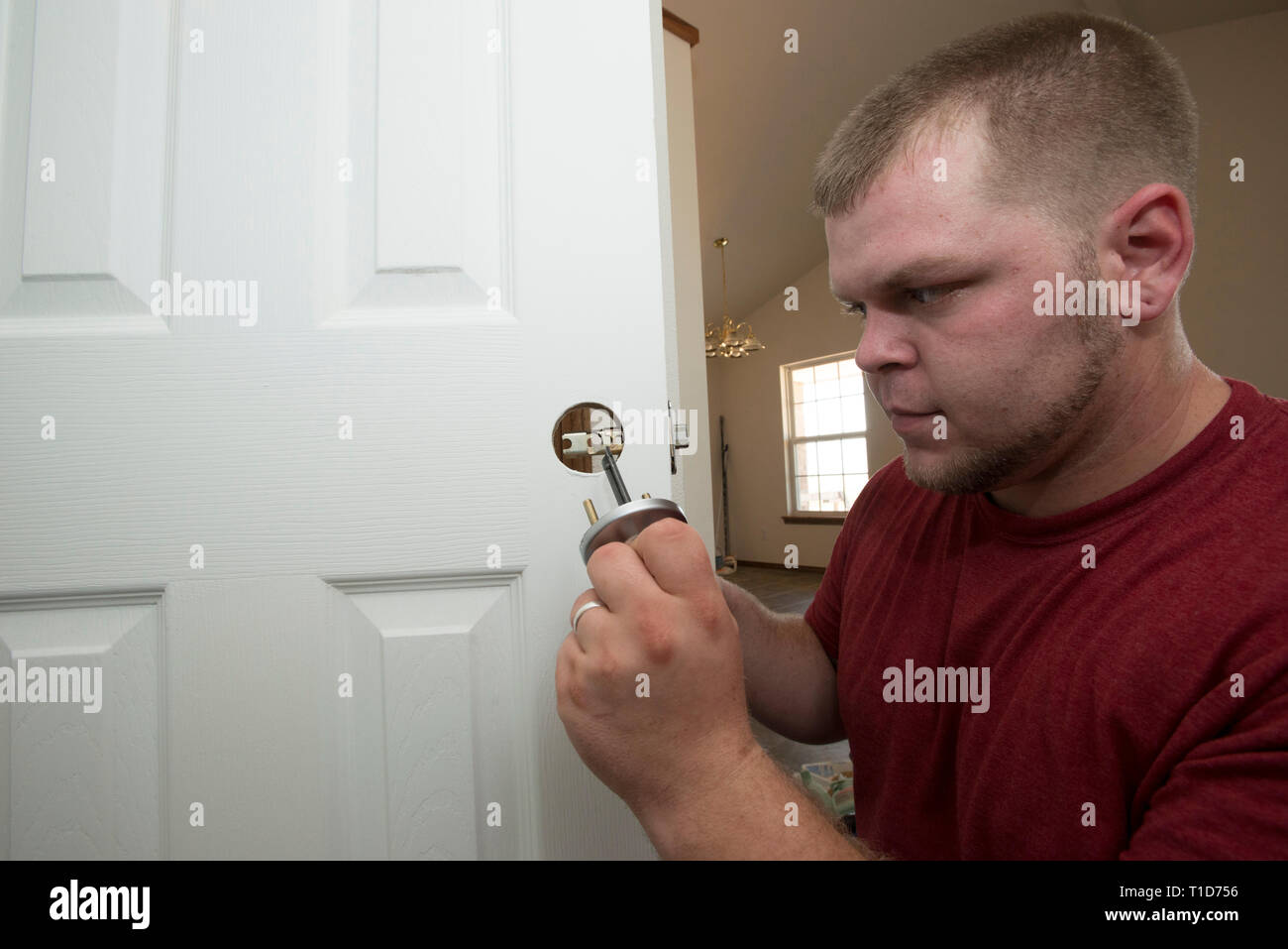 A man works on his family's self-help home in Oklahoma. Self-help housing is supported by the U.S. Department of Agriculture (USDA), Rural Development - Stock Image