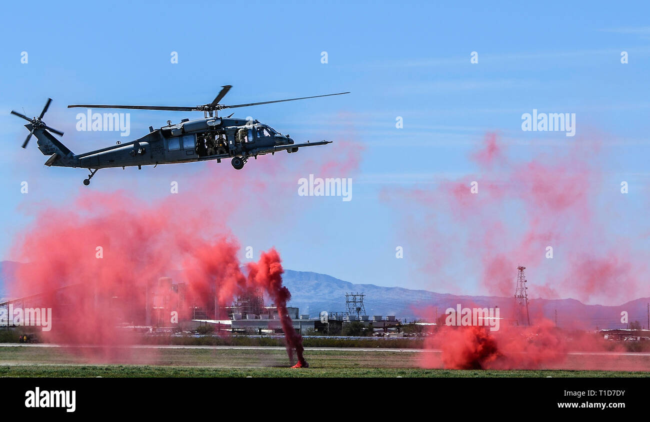A U.S. Air Force HH-60G Pavehawk performs a combat search and resuce demonstration during the 2019 Thunder and Lightning Over Arizona Airshow and Open House at Davis-Monthan Air Force Base, Ariz., March 24. During CSAR operations, the HH-60G Pavehawk helicopter and its crew set in hostile environments to recover downed aircrew and isolated personnel during day, night or marginal weather conditions. (U.S. Air Force photo by Senior Airman Giovanni Sims) - Stock Image