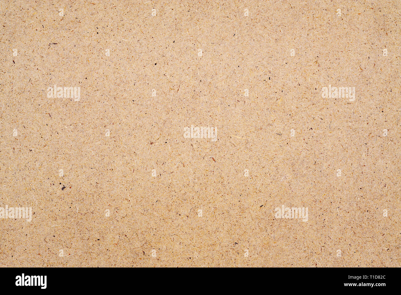 Close up of brown board wood texture made of recycled paper wood for background usage - Stock Image
