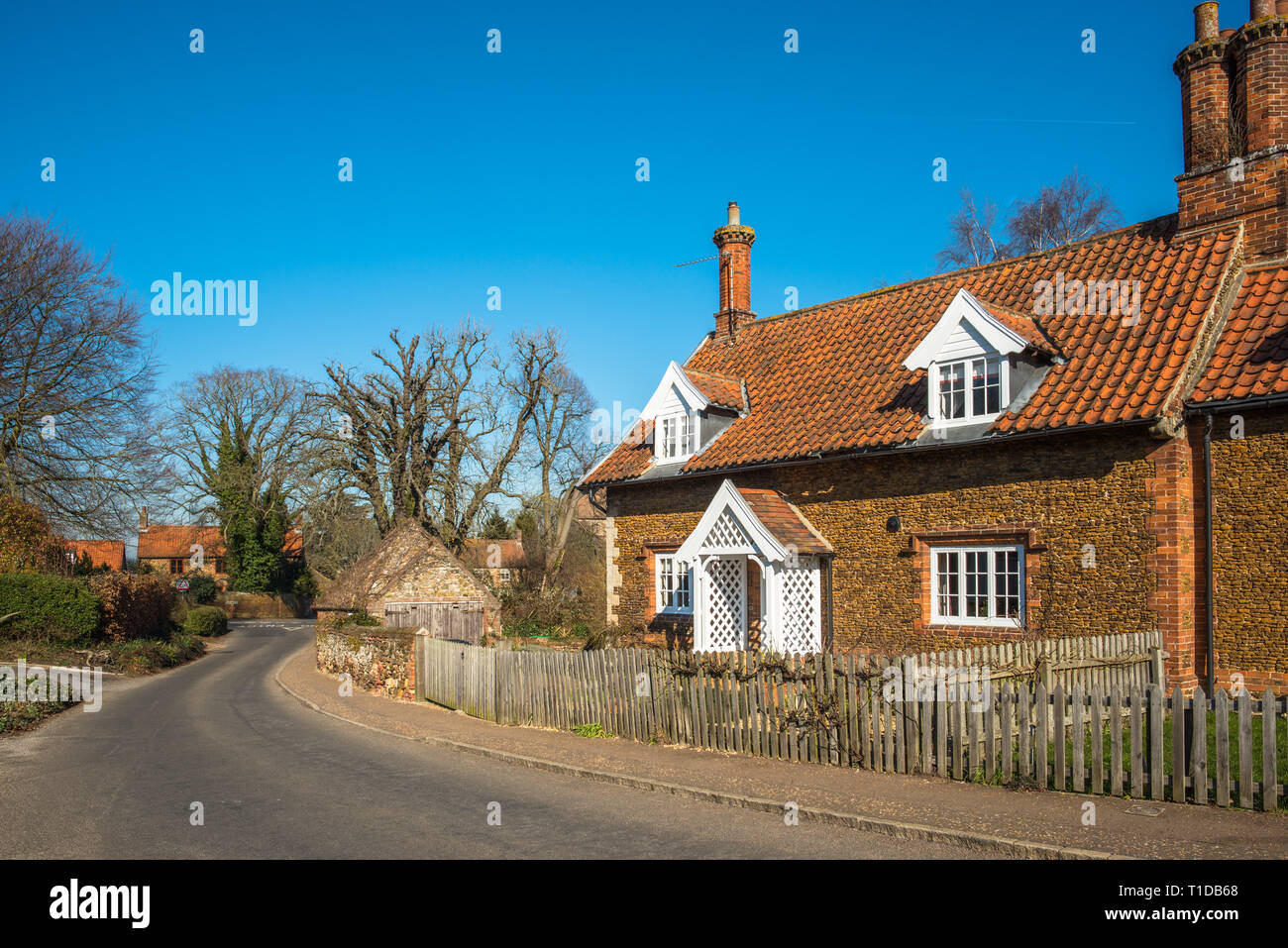 Characterful cottages in the village of Castle Rising in Norfolk, East Anglia, England, UK. Stock Photo