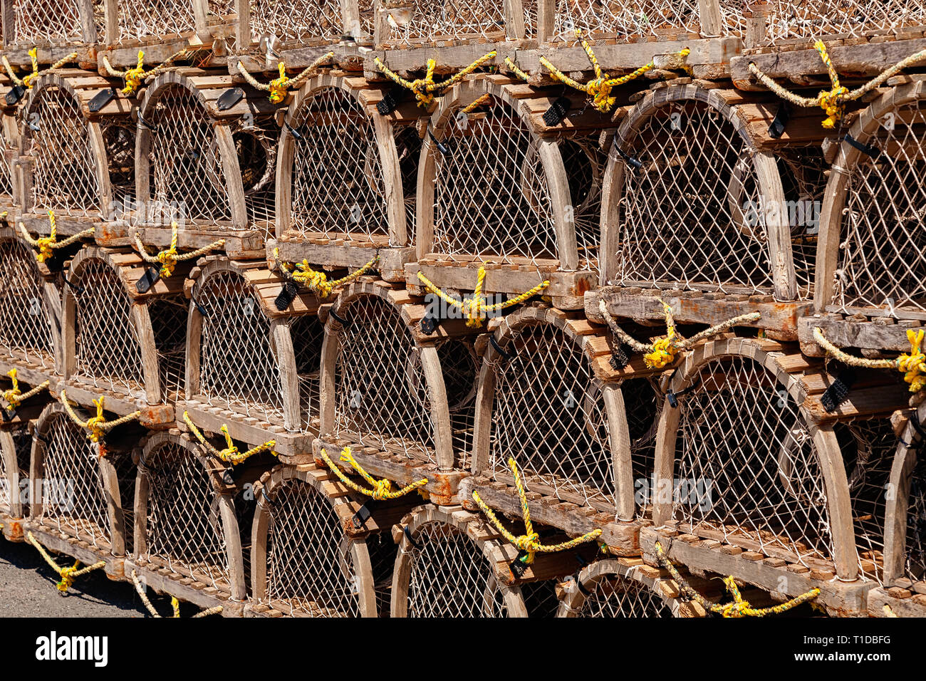 Stack of traditional wooden lobster traps for the commercial lobster fishery. - Stock Image