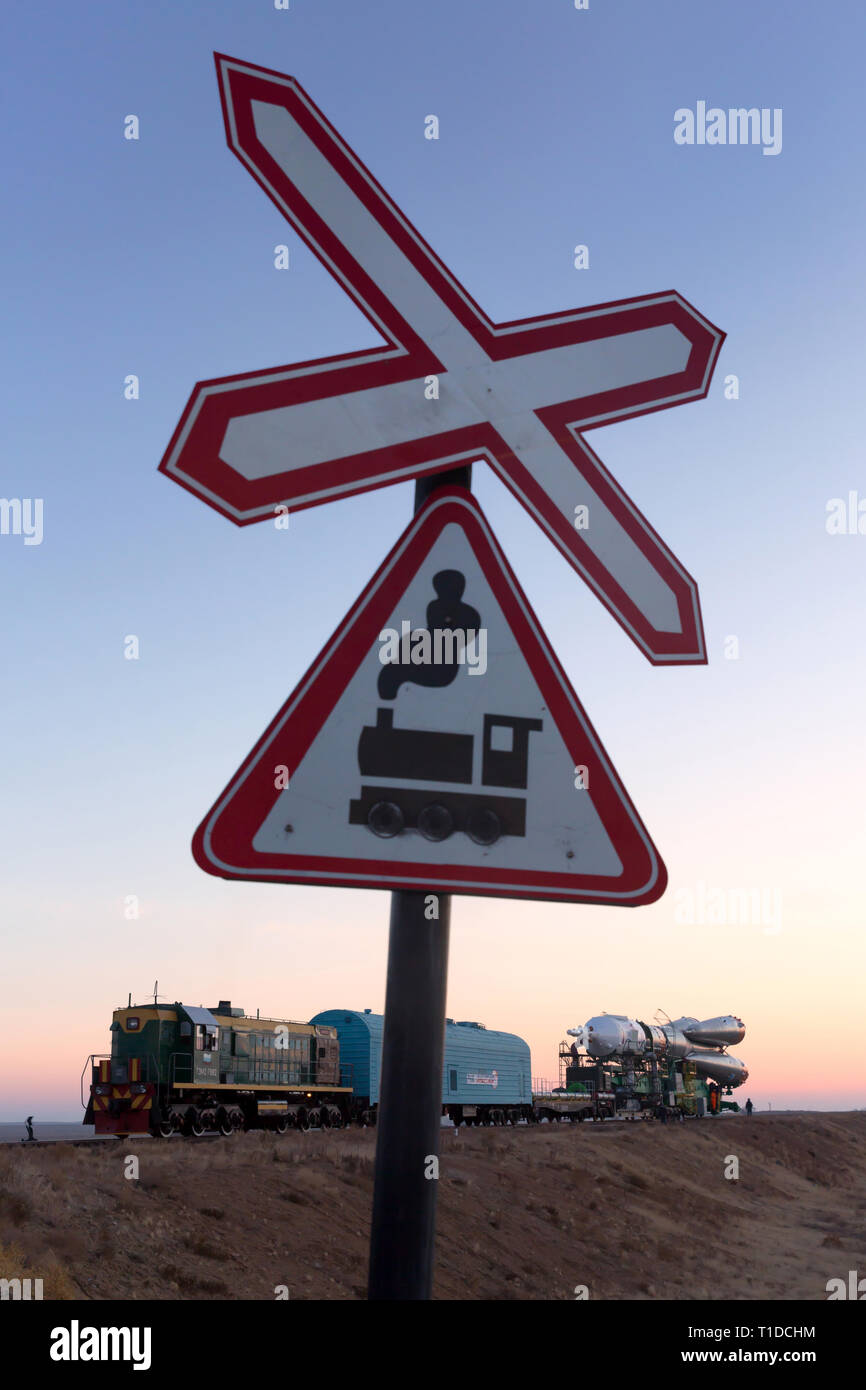BAIKONUR - The Soyuz rocket MS-03 is beeing rolled out by train to the Gagarin Start launchpad on monday and is seen at a train crossing. - Stock Image