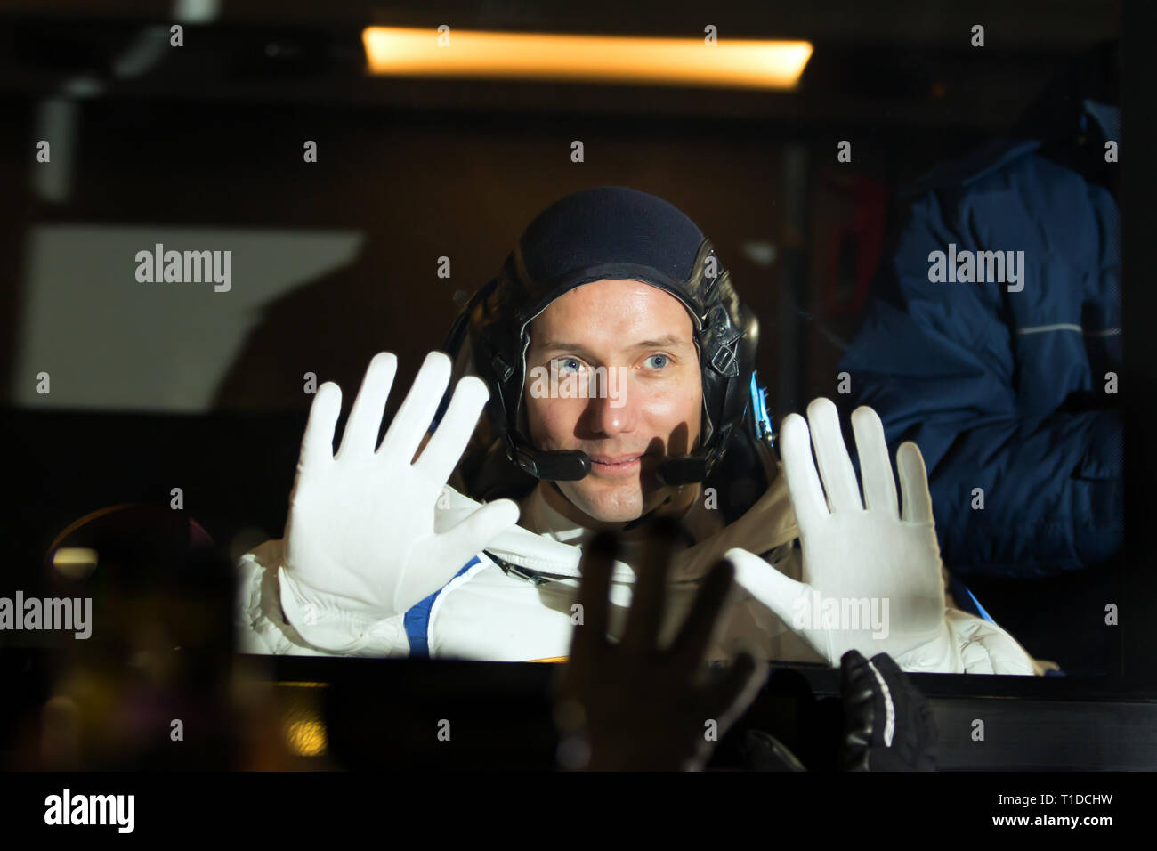 BAIKONUR - French astronaut Thomas Pesquet puts his hands on the window of a bus at the cosmodrome that will carry him to the Gagarin Launchpad - Stock Image
