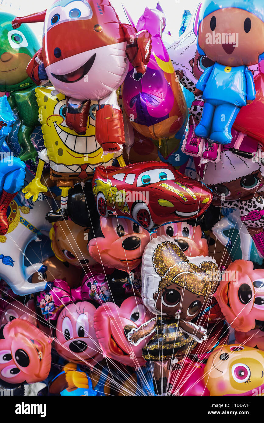 Plastic Balloons.plastic balloons with different faces of cartoon characters - Stock Image