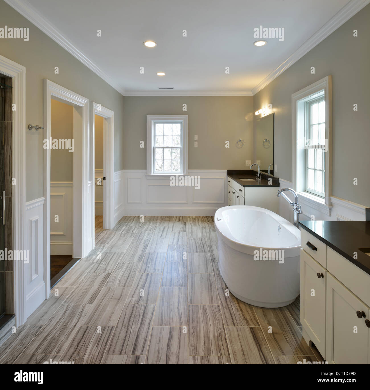 Modern Master Bathroom Design With Freestanding Bathtub Separated Sink Vanities Shower And Toilet Rooms Stock Photo Alamy