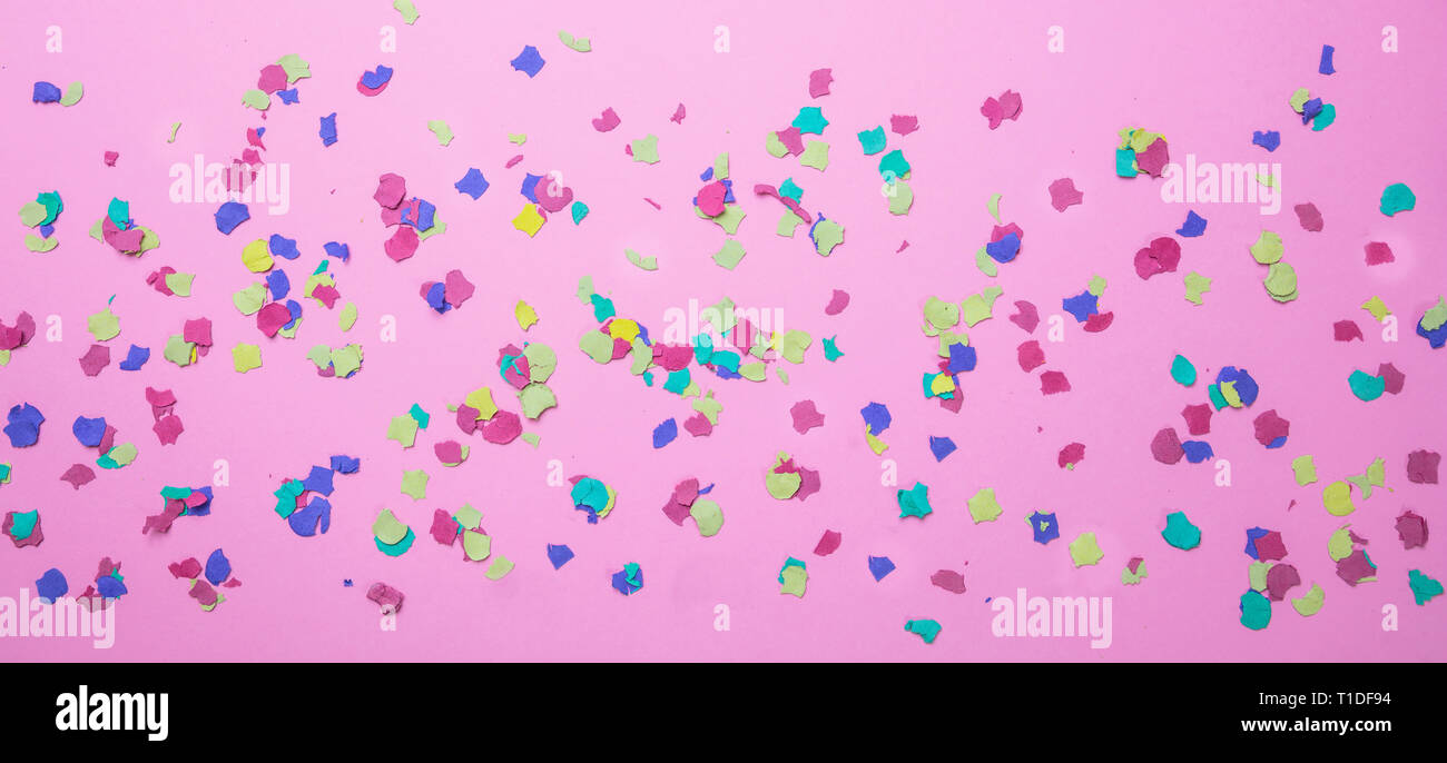 Carnival, birthday party  Colorful confetti on pink