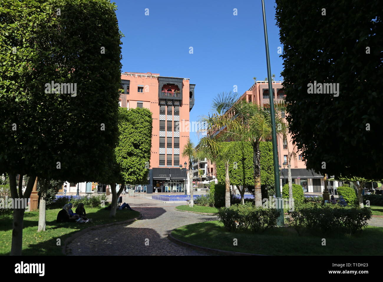 Shopping plaza at Place du 16 Novembre, New City, Marrakesh, Marrakesh-Safi region, Morocco, north Africa - Stock Image