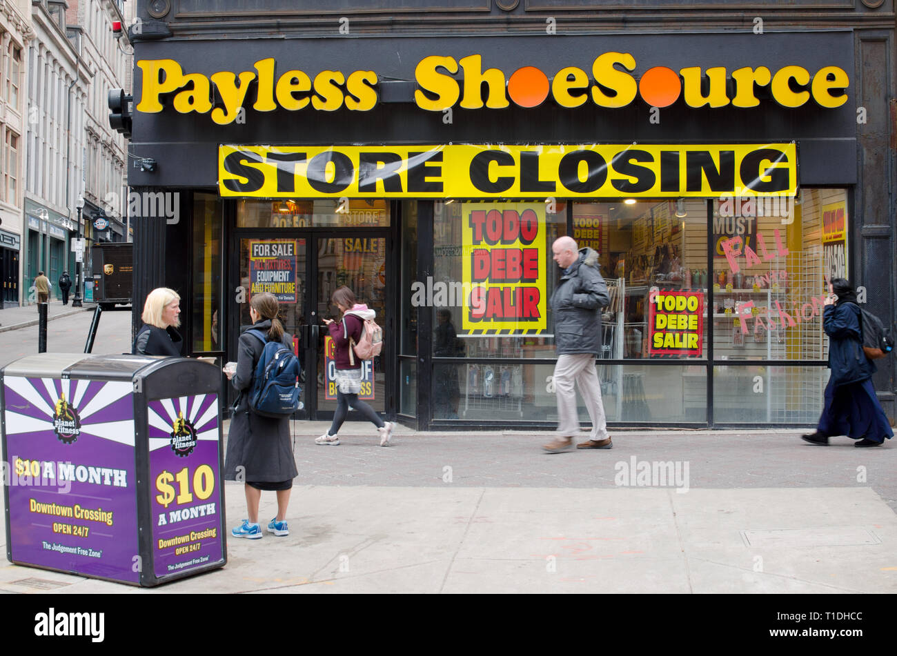 Payless Shoe Source store closing with people in motion on sidewalk in Downtown Crossing Boston, Massachusetts USA - Stock Image