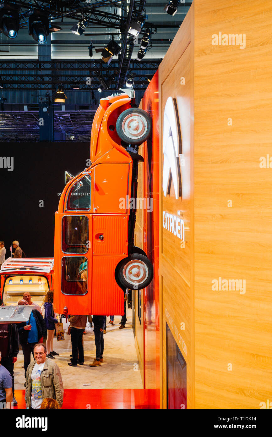 PARIS, FRANCE - OCT 4, 2018: Modern decoration of exibition with vintage Citroen van on the wall and customers curious visitors admiring the cars at International car exhibition Mondial Paris Motor Show - Stock Image