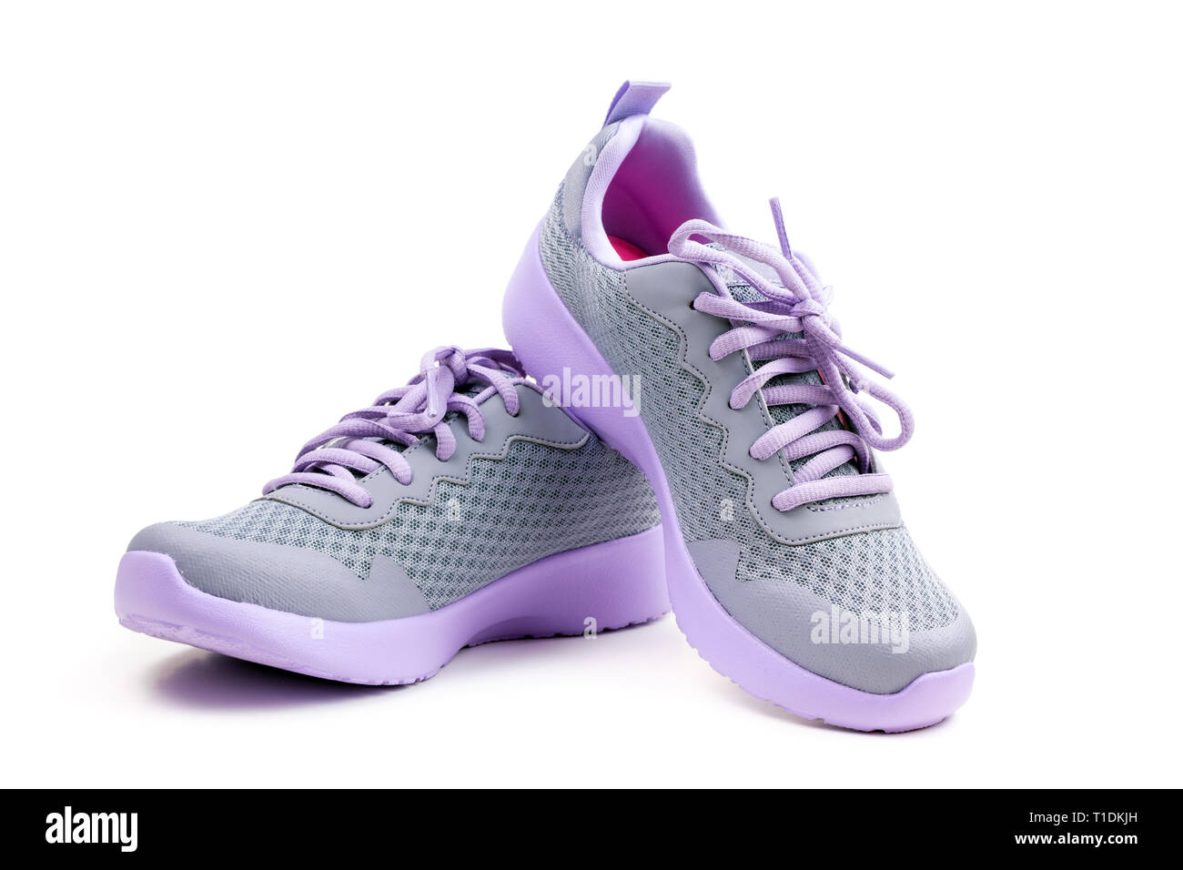Unbranded purple running shoes on a white background Stock Photo