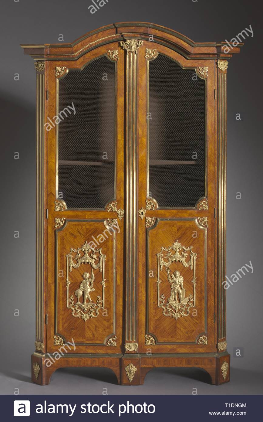 Bookcase, c. 1720. Attributed to Charles Cressent (French, 1685-1768). Kingwood and rosewood veneers, gilt metal mounts; overall: 247.6 x 132.1 x 57.2 cm (97 1/2 x 52 x 22 1/2 in.). - Stock Image