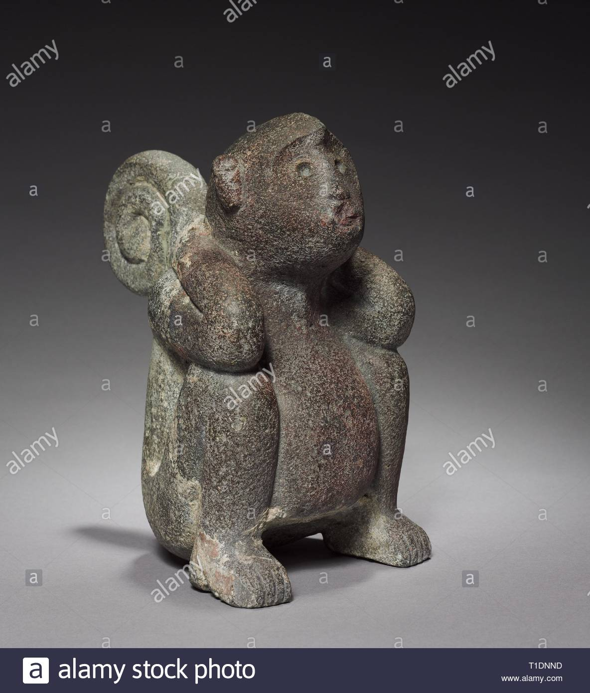 Monkey, 1325-1519. Central Mexico, Tacuba, Aztec, Post-Classic Period. Stone; overall: 24.5 x 14.5 x 20.5 cm (9 5/8 x 5 11/16 x 8 1/16 in.). - Stock Image