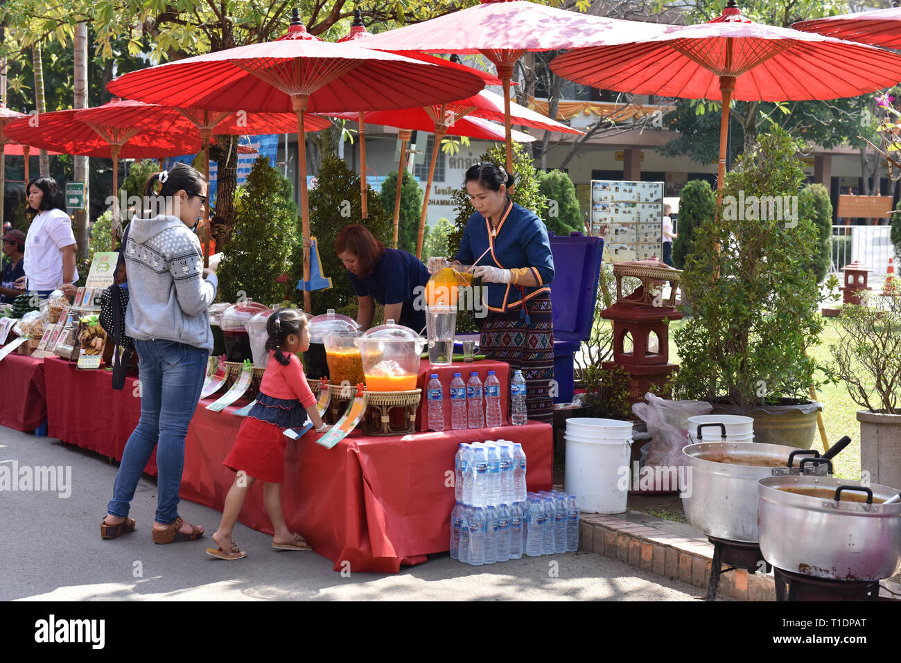 Street food being sold in front of Wat Phra Singh Temple in Chiang Mai every Weekend - Stock Image