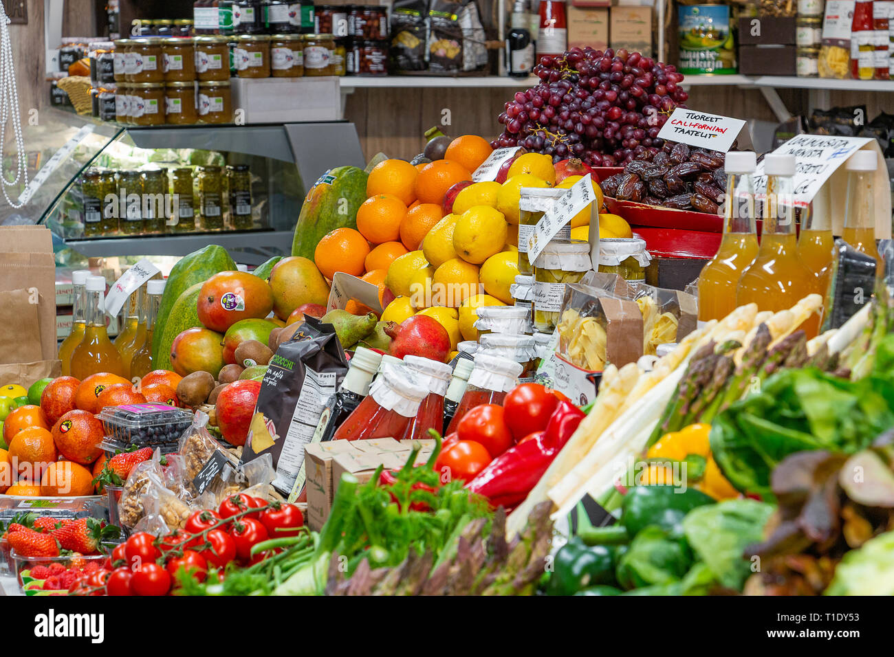 Helsinki, Finland - March 19, 2019: Various vegetables and food jars in the Market Hall - Stock Image
