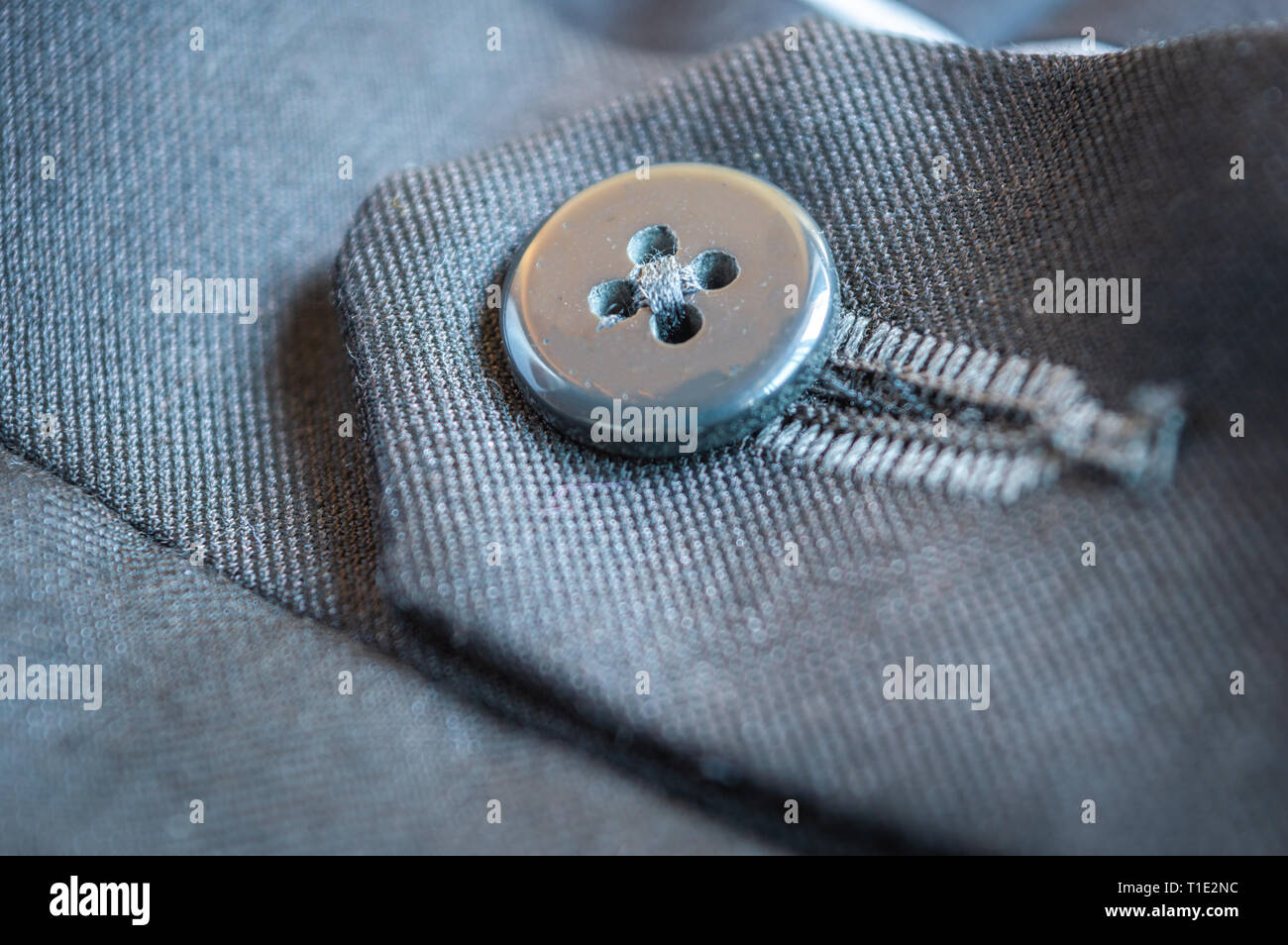 Close up of the button of a grey formal pant Stock Photo